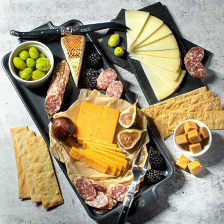 Cheese Board Meating Gift with Manchego Cheese, Westminster Cheddar from Great Britain, olies, salami, Firehook crackers and DLM Caramels